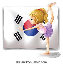 A ballet dancer in front of the South Korean flag