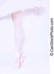 A ballet dancer standing on toes while dancing on pink background artistic conversion