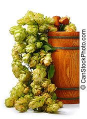 A barrel of beer with hop cones