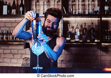 A bartender working behind the bar counter