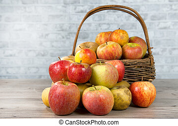 basket of apples on the wooden table