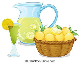 A basket of lemon beside the pitcher with lemonade -...