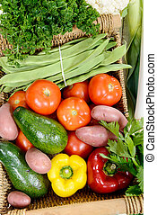 basket of seasonal vegetables on  wooden table
