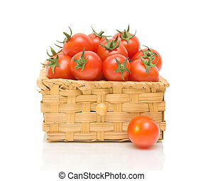 a basket of tomatoes on a white background