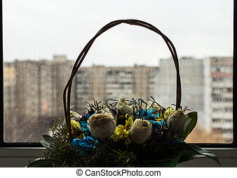 basket with flowers on the window