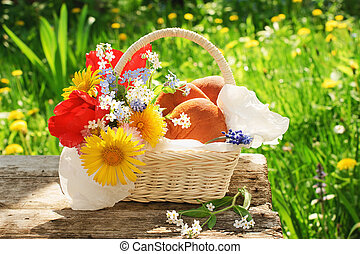 A basket with pasties and flowers in the garden