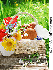 A basket with patties and flowers in the garden