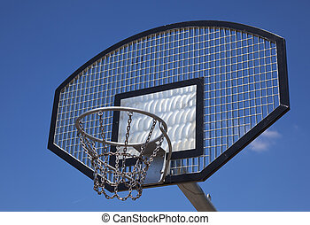 a basketball basket with blue sky