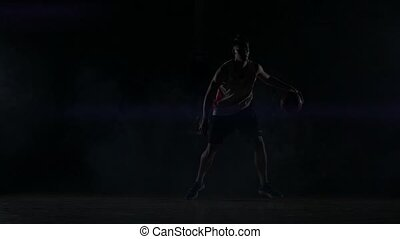 A basketball player dribbles down the court out of the ...