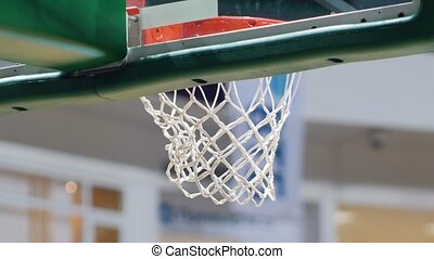A basketball tournament. Throwning a ball in a basketball hoop. Hitting the target