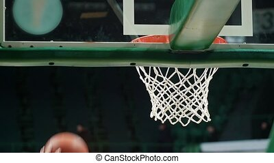 A basketball tournament. Throwning a ball in a basketball...
