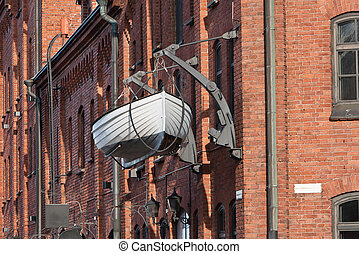 a be hanging boat on old red brick wall