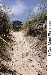 A beach house framed by the sand dunes in the Outer Banks,...