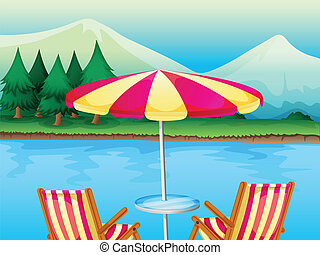 A beach umbrella with chairs