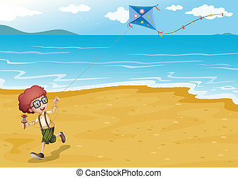 A beach with a boy playing
