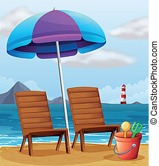 A beach with an umbrella and chairs