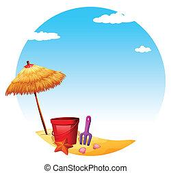A beach with an umbrella and toys
