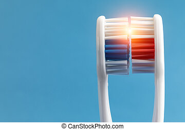 beam of light between two toothbrushes - a beam of light...