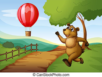 A bear running after the hot air balloon