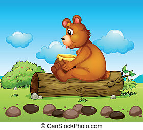 A bear sitting down on the trunk of a tree