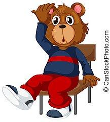 A bear sitting on a chair