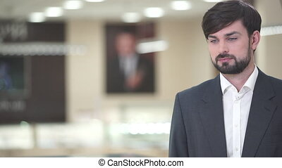 A bearded man in a suit