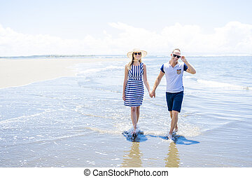 A beautiful and happy couple having fun at the beach of Costa Rica