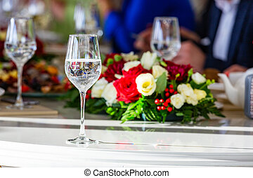 A beautiful banquet table with snacks and flowers on the table. Selective focus