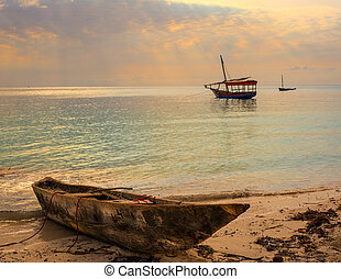 Traditional Fisherman's Dhow boat anchored at sunset