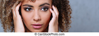 A beautiful black woman portrait. Tests the emotion of ...