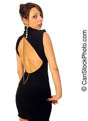 A beautiful brunette in an elegant evening dress
