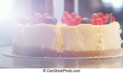 A beautiful cake with currant on the top