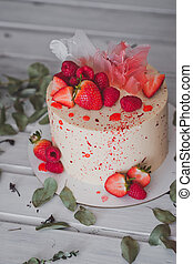 A beautiful cake with strawberry berries as decoration 999....