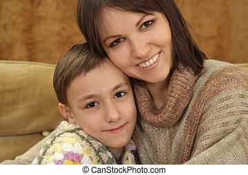 A beautiful Caucasian mum and a charming son sitting