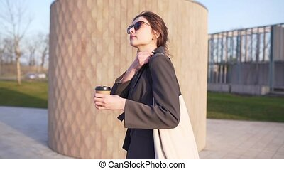 A beautiful Caucasian woman walks in park with a cotton eco ...