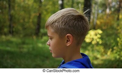 a beautiful child is walking along the alley in the park. Outdoor Activities