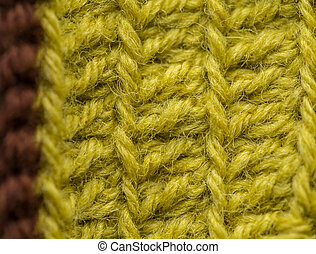 A beautiful closeup of a hand made crochet pattern of a colorful wool yarn. Soft and warm natural sheep wool.