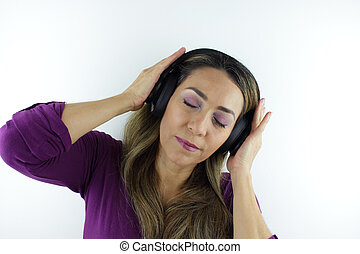 A Beautiful Colombian woman listening to music