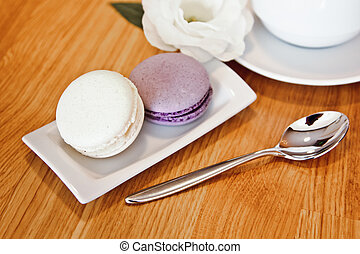 A beautiful colorful macaroons on wooden background