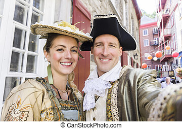 beautiful couple in long medieval dress outside in quebec city