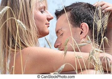 A beautiful couple in wheat field