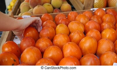 A beautiful dynamic view of healthy fruit food. persimmon on the counter. 4k. Slow motion