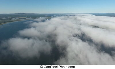 a beautiful flight over the clouds