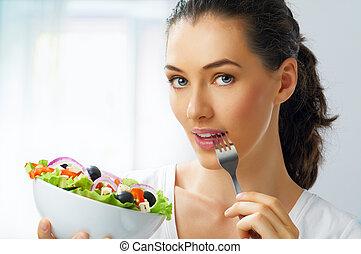 eating healthy food - A beautiful girl eating healthy food