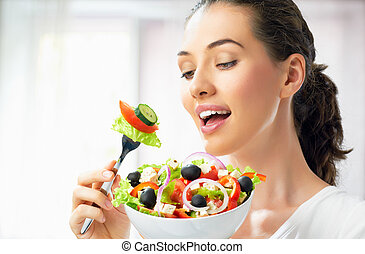 eating healthy food - A beautiful girl eating healthy food