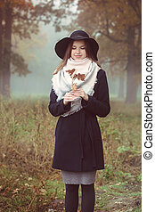 A beautiful girl in a coat and hat
