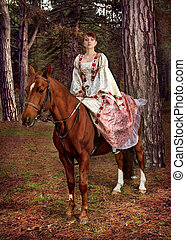 beautiful girl in antique dress on horseback - a beautiful...