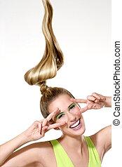 a beautiful girl showing long windy hair