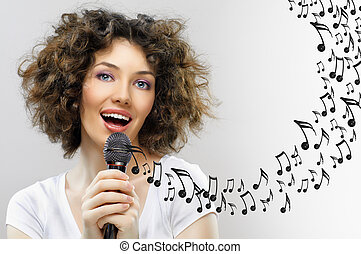singing into a microphone - a beautiful girl singing into a...