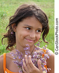 A beautiful girl with a bouquet of wildflowers